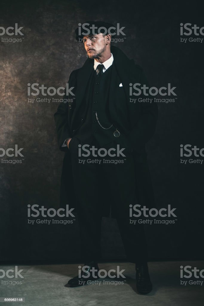 Retro 1920s english gangster. Peaky blinders style. stock photo