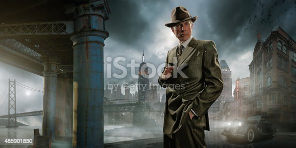 Retro image of a 1940's film noir mature gangster / private detective wearing a suit and fedora hat, pulling out a pistol / gun from his jacket. He stands on a dock by a vintage car with a generic city in the background, under a dark and stormy evening sky. Sign is fictional.