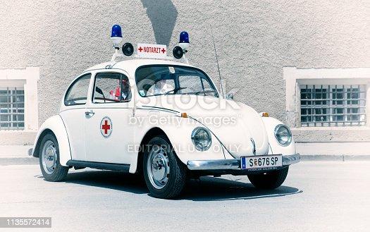 Salzburg / Austria - May 2018. Retro 1970s Red cross Volkswagen Beetle emergency doctors vehicle - ambulance.