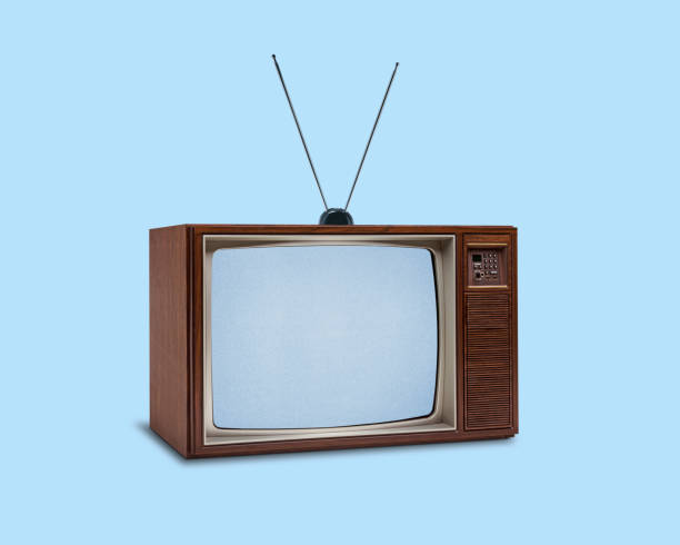 Retro 1970's Television On Blue Background stock photo