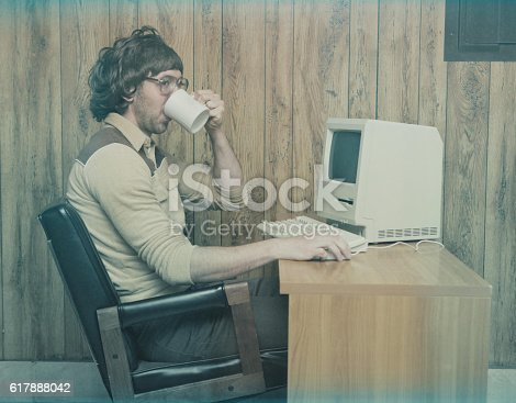 618210072 istock photo Retro 1980s computer worker drinking coffee 617888042