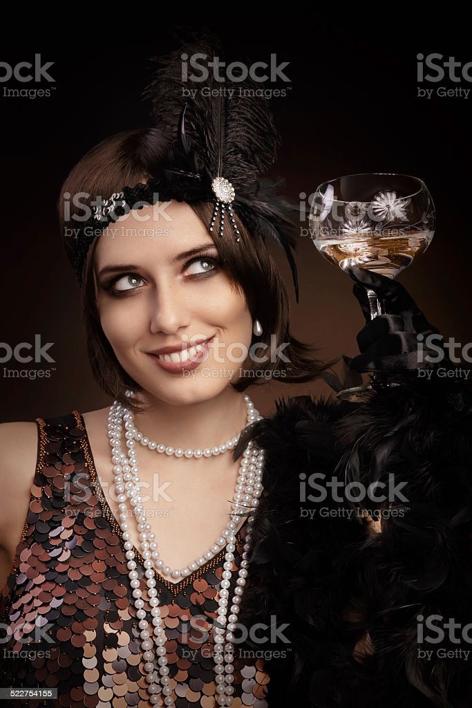 Retro 20s style woman holding champagne glass stock photo