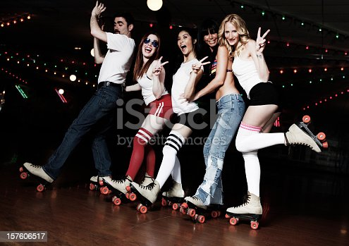 Group of friends enjoying themselves at the roller disco.