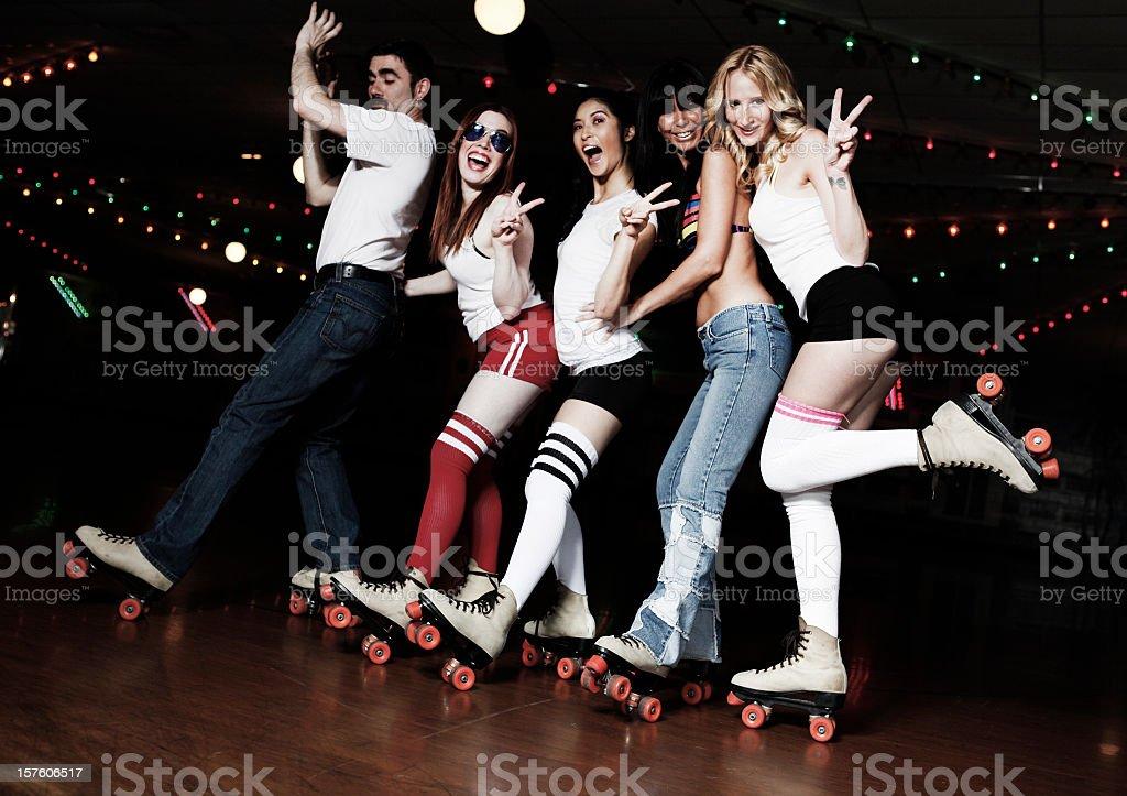 Retro 70's Roller Disco Conga Line stock photo
