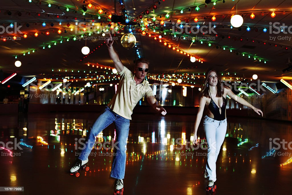 Retro 70's Roller Disco Couple stock photo