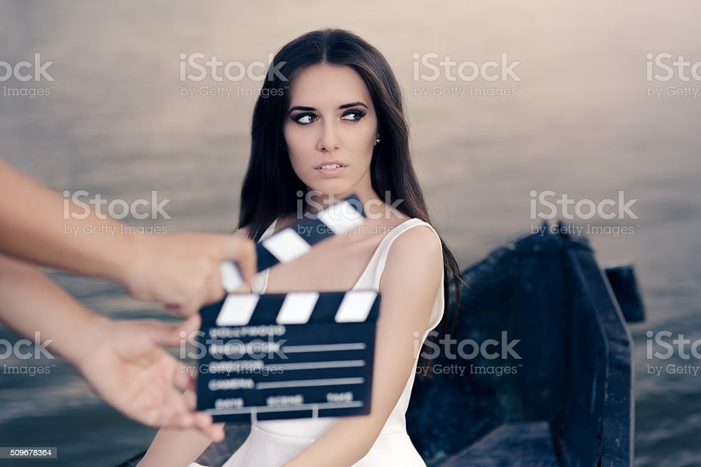 Retro Actress Shooting Movie Scene in a Boat stock photo