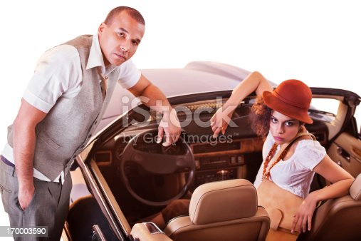 istock Retro African-American couple in old timer car. 170003590