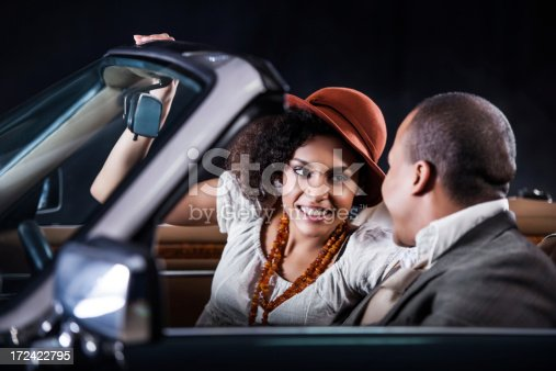 istock Retro African-American couple in old timer car. 172422795