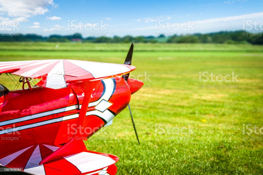 Retro airplane ready to take of on a green field stock photo