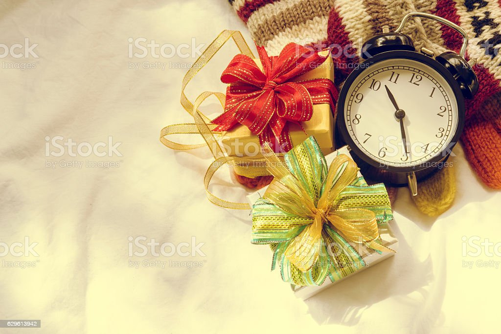 Retro alarm clock, gift boxes and Christmas decoration on vintag stock photo