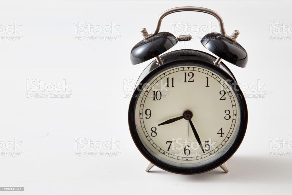 Retro alarm clock on a table - Royalty-free Alarm Stock Photo