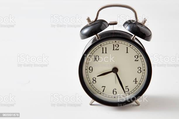 Retro Alarm Clock On A Table Stock Photo - Download Image Now