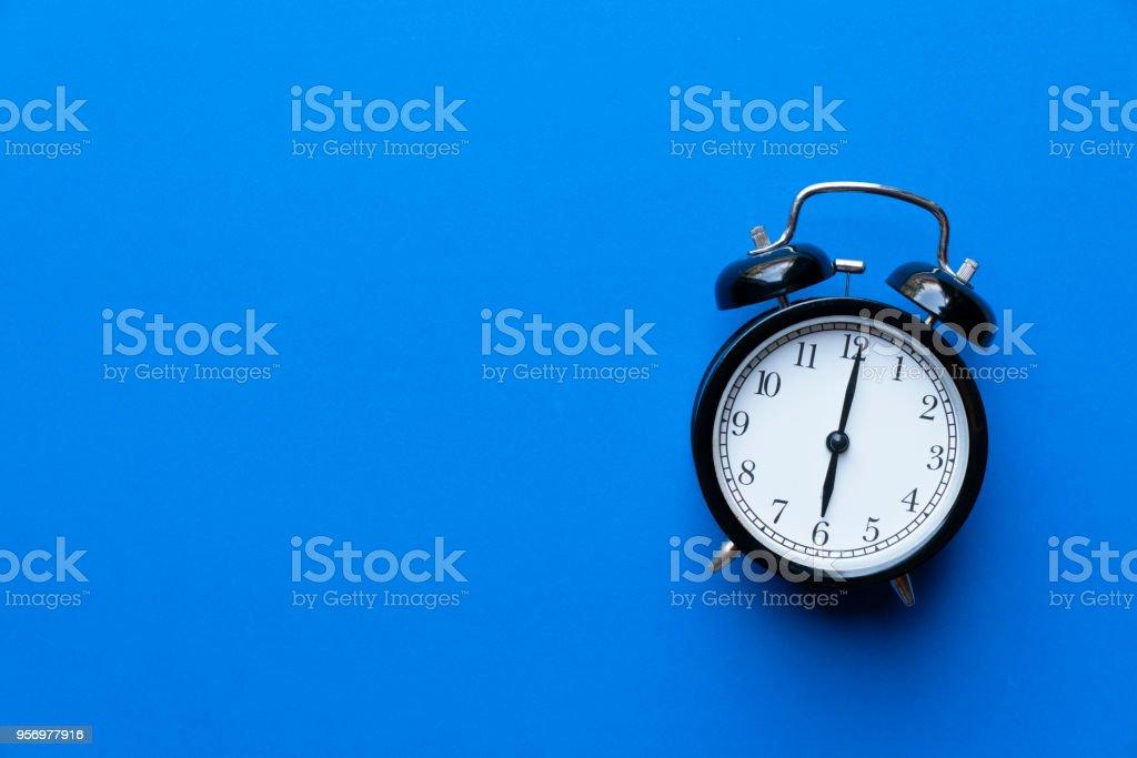 Retro Alarm Clock On Blue Background Vintage Style Stock Photo