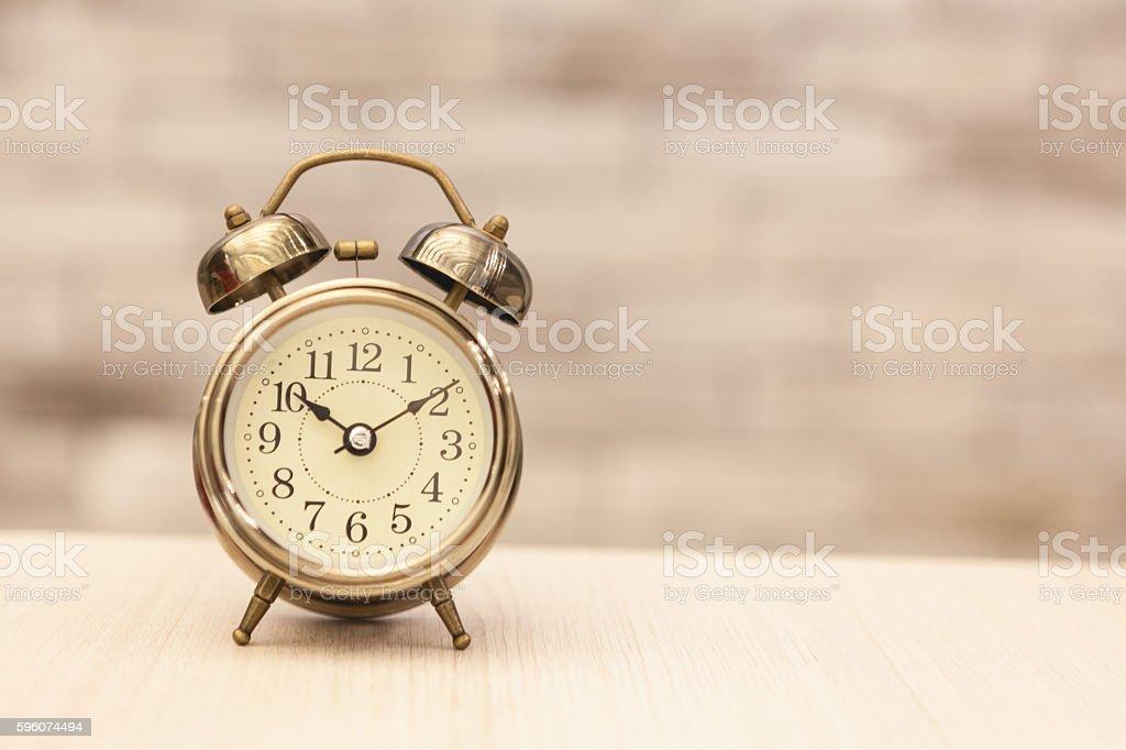 Retro alarm clock on table royalty-free stock photo