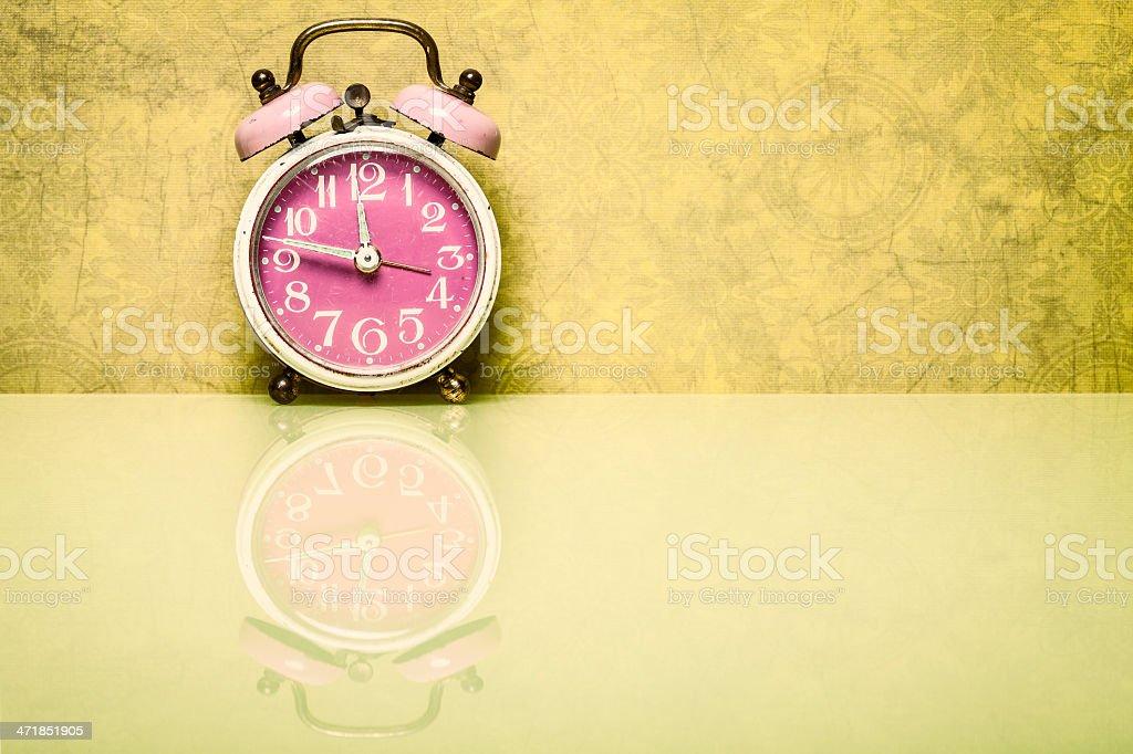 Retro Alarm Clock On Vintage Wallpaper Royalty Free Stock Photo