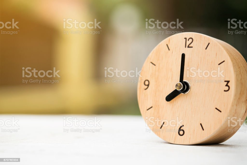 Retro alarm clock on wooden table, vintage style stock photo