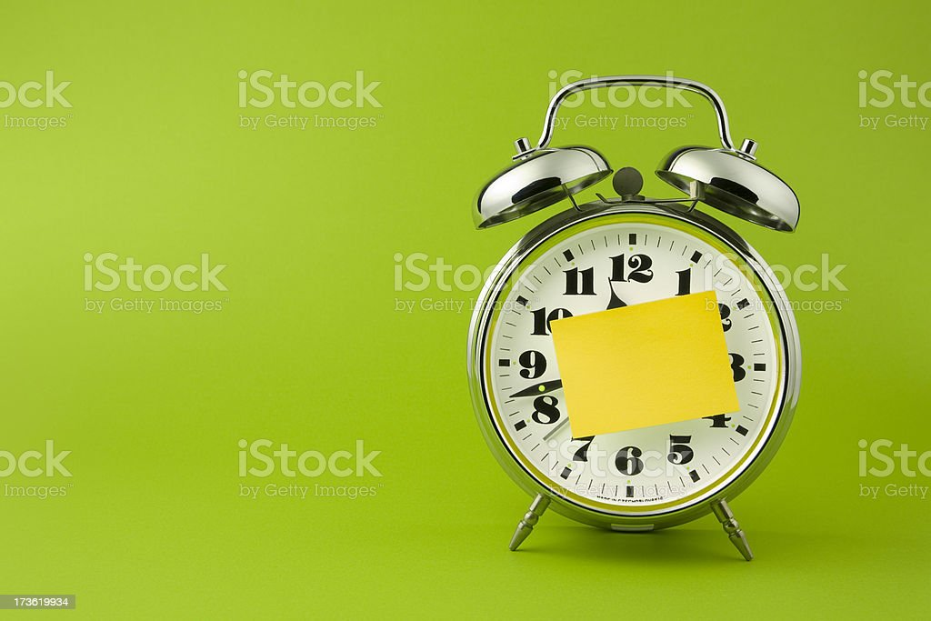 Retro alarm clock with sticky note pad. Deadline Time royalty-free stock photo