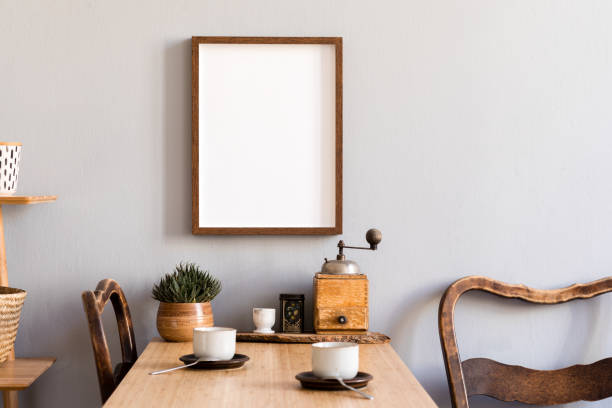 Retro and stylish interior of kitchen space with small wooden table with brown mock up photo frame, design cups and vintage chairs.Scandinavian room decor with kitchen accessories and succulents. Scandinavian kitchen room decor with accessories and furnitures. kitchen photos stock pictures, royalty-free photos & images
