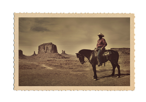 Subject: A retro postcard of a Cowboy and the landscape of the American Southwest. The image on the postcard is an original photograph produced for this stock photo, it is not a scan copy of an actual postcard image.