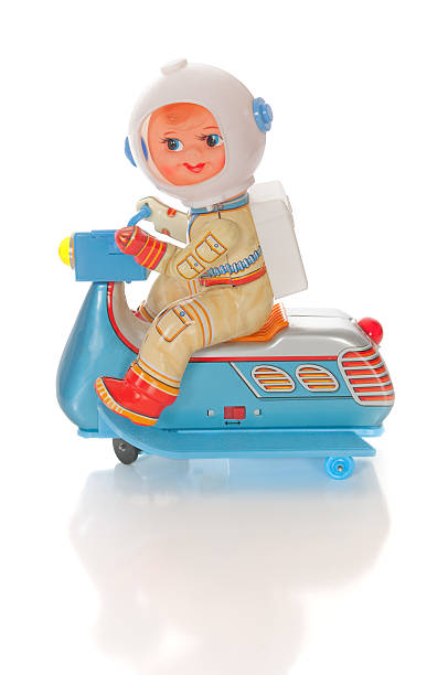 Retro Astronaut Riding Space Scooter stock photo