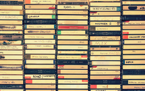 Retro audio cassettes boxes A background pattern made of vintage audio cassettes boxes audio cassette stock pictures, royalty-free photos & images