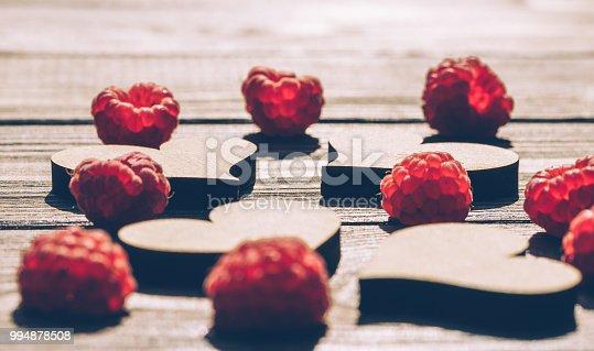 914465180 istock photo Retro background. Hearts and raspberries 994878508