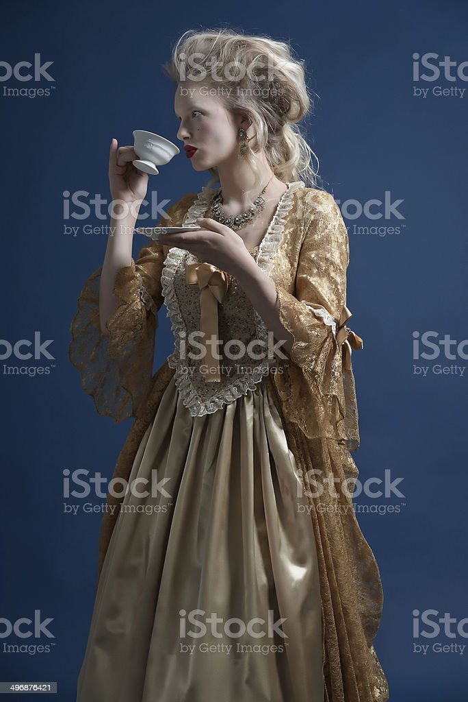 Retro baroque fashion woman wearing gold dress. royalty-free stock photo