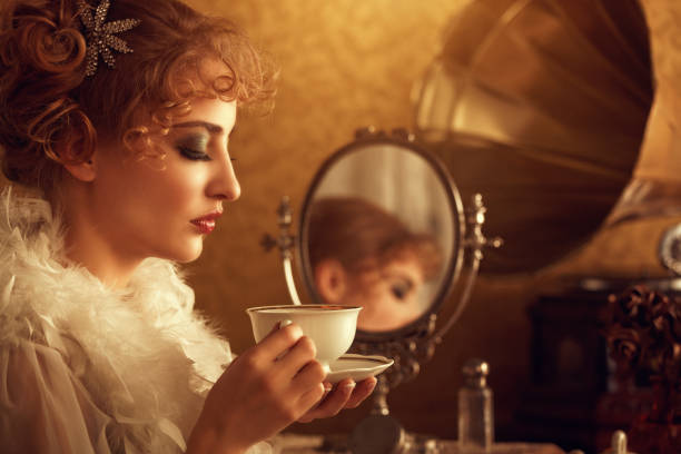 retro beauty drinking coffee in the morning retro beauty drinking coffee in the morning early 20th century stock pictures, royalty-free photos & images