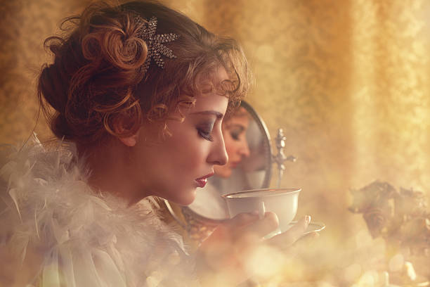 retro beauty drinking coffee in the morning retro beauty (behind a lace curtain) drinking coffee in the morning  early 20th century stock pictures, royalty-free photos & images