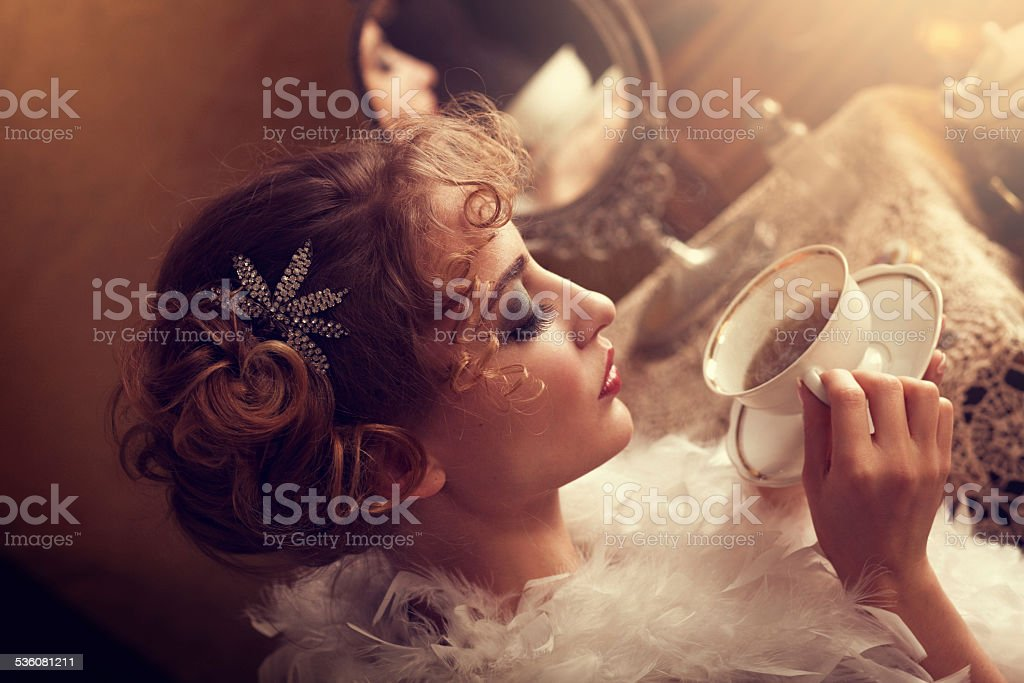 retro beauty drinking tea or coffee in the morning stock photo