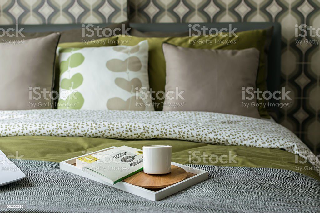 retro bedroom style with cup of tea and books stock photo