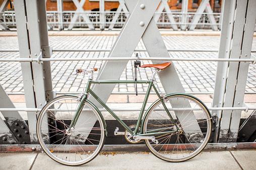 Retro bicycle near the bridge