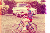 retro photo grom the seventies of a boy on a blue bicycle. Original photographic slide.