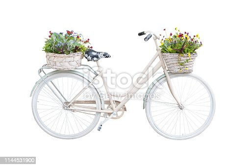 Retro bicycle with floral baskets isolated on white background. Vintage vehicle
