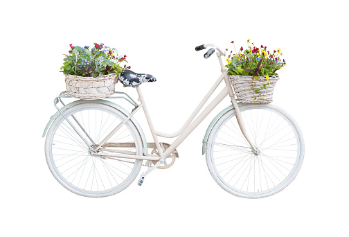 Retro bicycle with floral baskets isolated