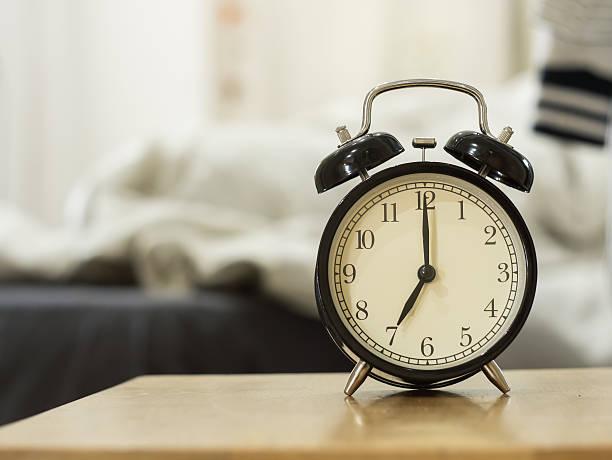 Retro black alarm clock stock photo