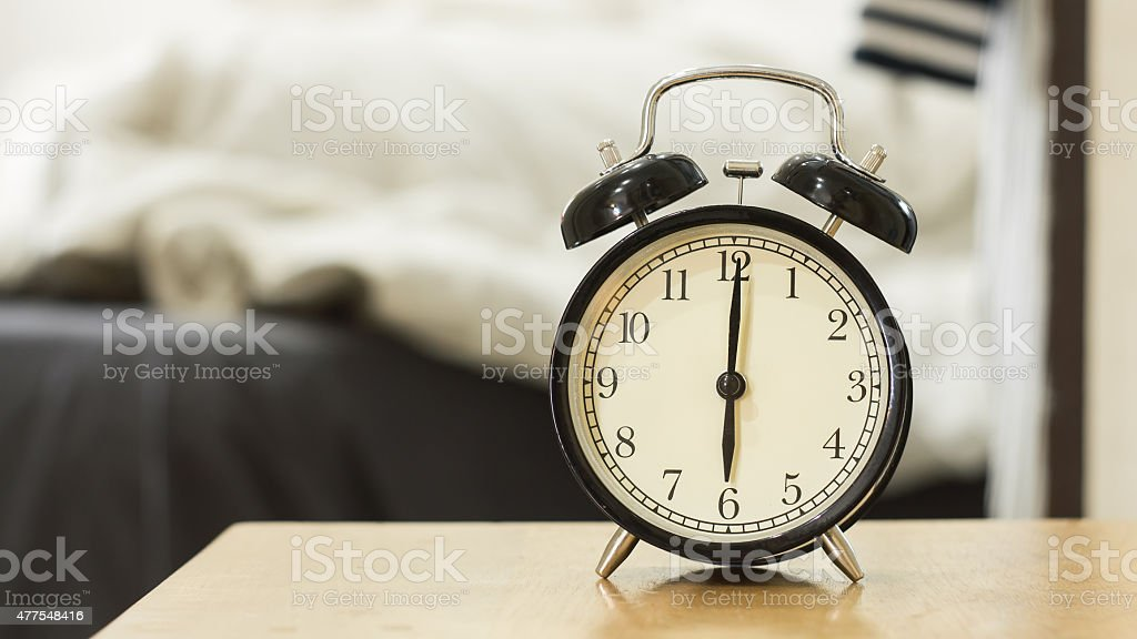 Retro black alarm clock show 6 o'clock in the morning stock photo