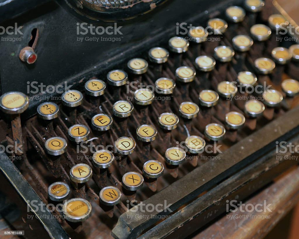 retro black rusty typewriter with white keys stock photo