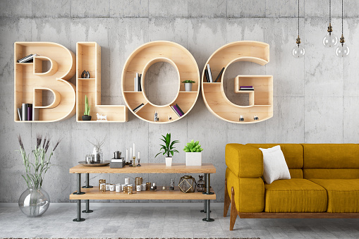 Blog bulb sign on black brick wall with armchair