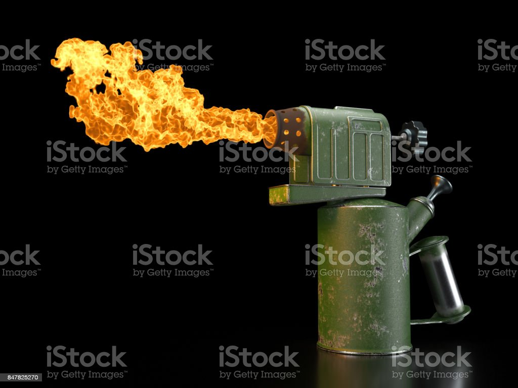 Retro blowtorch fire on black background stock photo