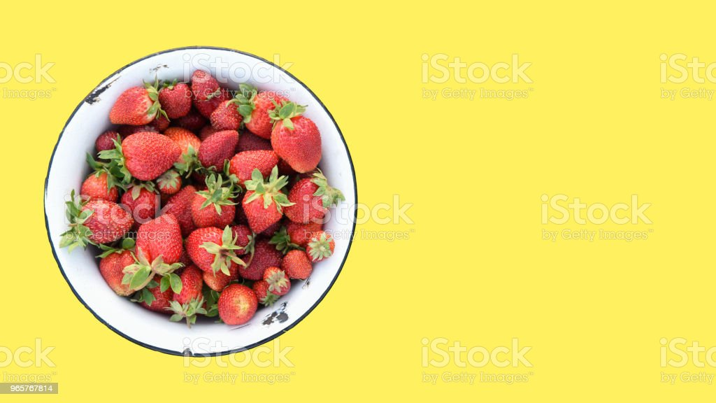 Retro bowl of fresh strawberries from own field, isolated on a yellow background, top view, copy space for text - Royalty-free Berry Stock Photo
