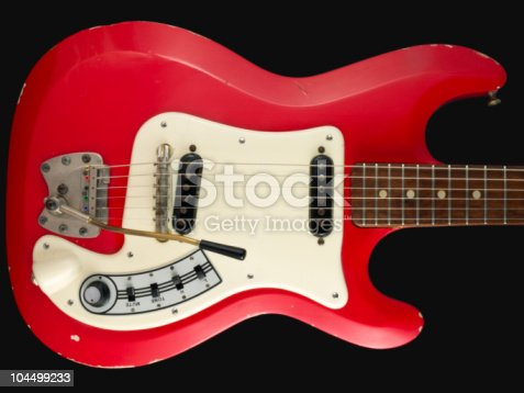 1183352589 istock photo Retro British red electric guitar body 104499233