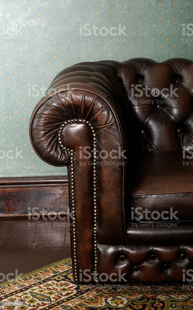 Retro Brown Leather Couch in Vintage Setting stock photo