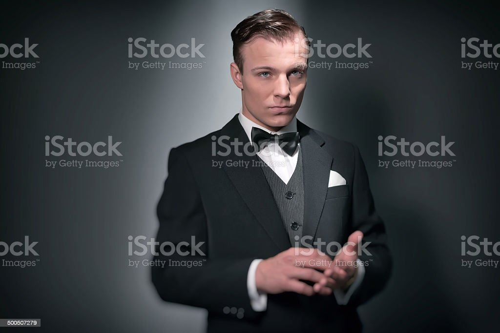 Retro business fashion man wearing black suit and bow tie. stock photo