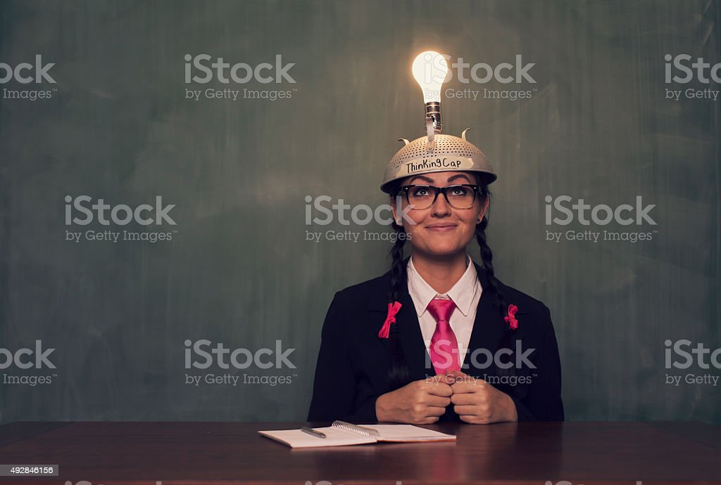 Retro Businesswoman with Thinking Cap is Happy stock photo