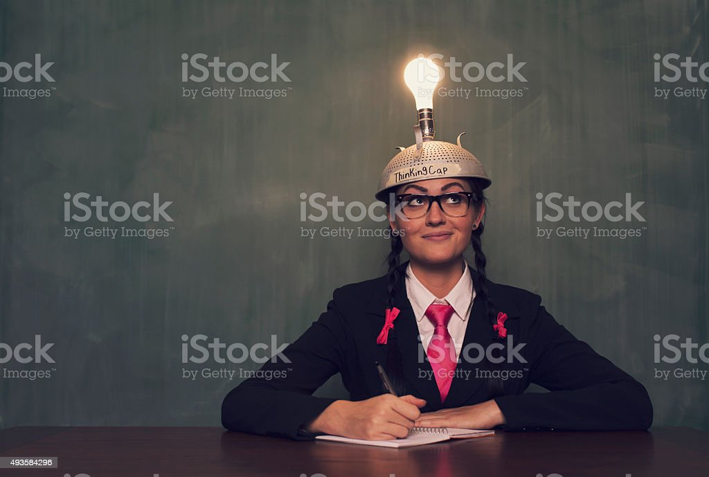 Retro Businesswoman with Thinking Cap is Thinking stock photo