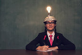 Retro Businesswoman with Thinking Cap is Thinking