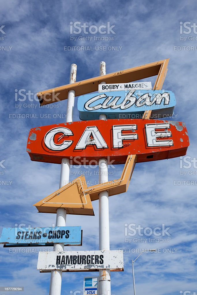 retro cafe sign and sky stock photo