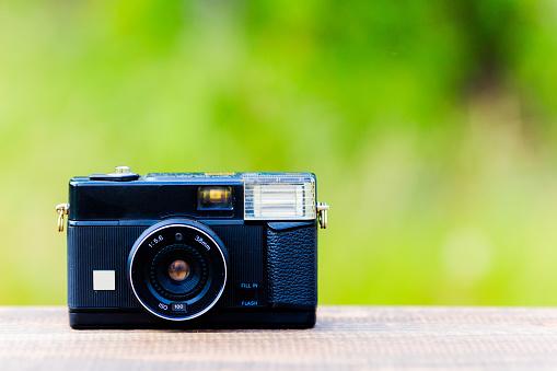 Retro camera and green blur background