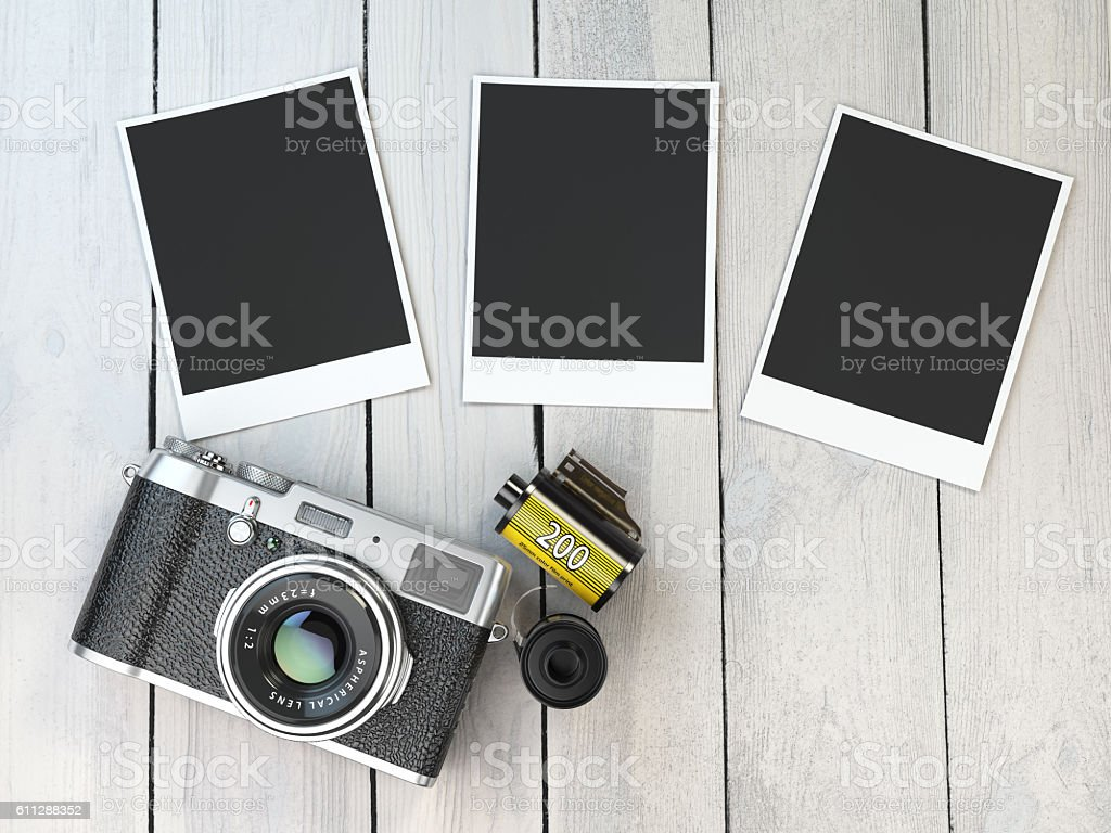 Retro camera, empty photo frames pictures and film canisterrs  o stock photo